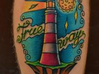 Татуировка маяк на икре