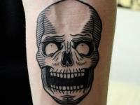 Татуировка череп на предплечьем