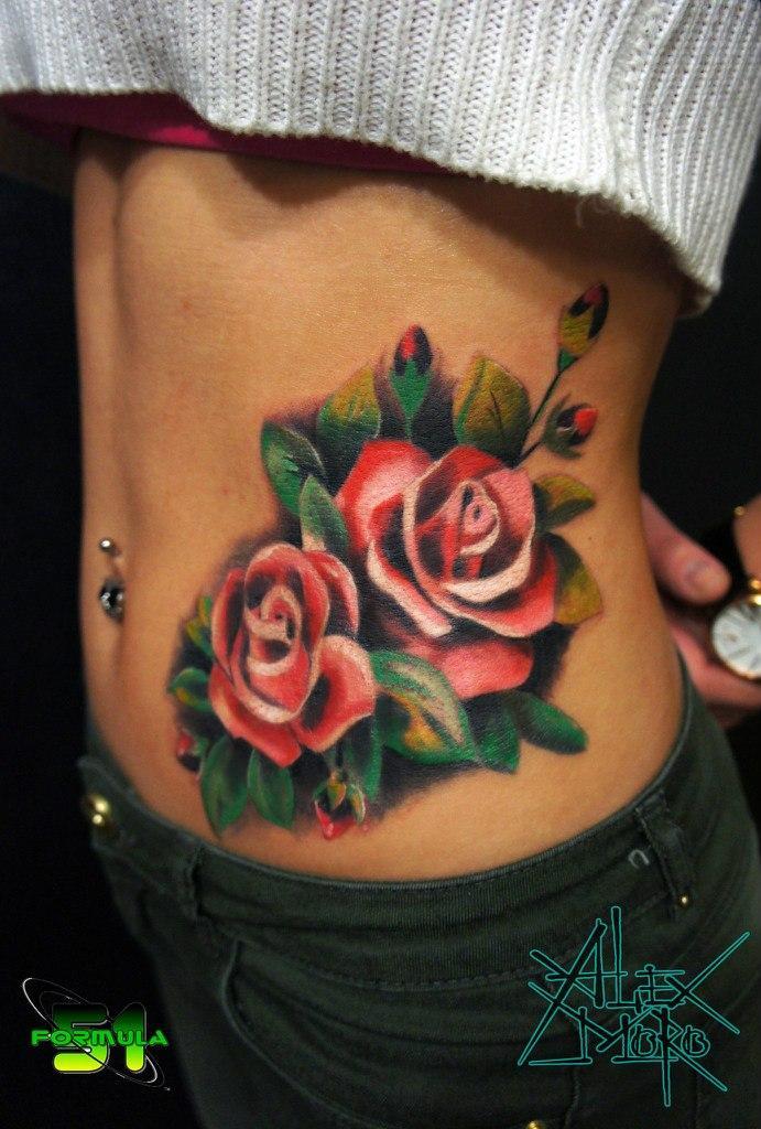 Идеи татуировок на животе для девушек и их значение