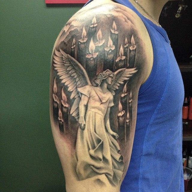 """Художественная татуировка """"Ангел со свечами"""". Мастер - Павел Заволока."""